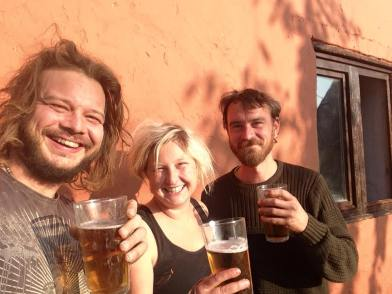 Gareth, Julia and Mike enjoying a local beer after two months hard graft
