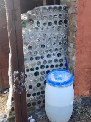 The unfinished glass bottle shower wall